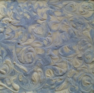 Ash layer on swirled lavender soap